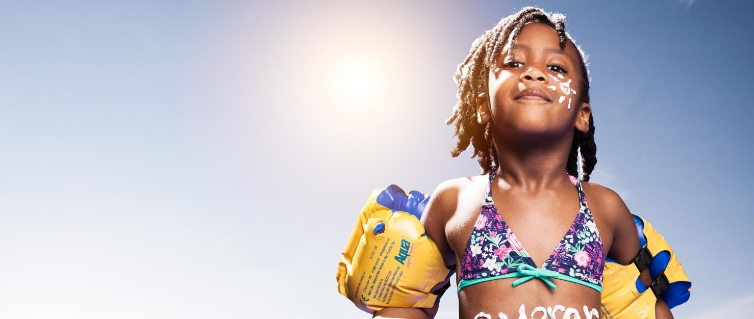 Kind met zonnebrandcreme